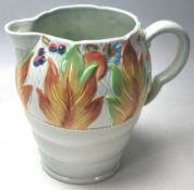 A CLARICE CLIFF WATER JUG WITH CELTIC LEAF AND BER