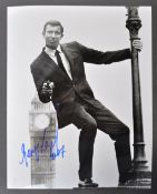 "JAMES BOND - GEORGE LAZENBY - RARE SIGNED 8X10"" PHOTOGRAPH"