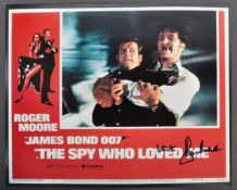 ROGER MOORE - JAMES BOND 007 - SIGNED LOBBY CARD - SPY WHO LOVED ME
