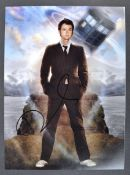 "DOCTOR WHO - DAVID TENNANT - SIGNED 10X14"" PHOTOGRAPH"