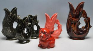 A COLLECTION OIF FIVE CERAMIC GUGGLE JUGS BY DARTMOUTH AND SHREVE