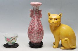 A GROUP OF THREE CHINESE PORCELAIN CERAMIC - CRACKLE GLAZE VASE - SITTING CAT - TEA BOWL