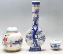 A 20TH CENTURY CHINESE ORIENTAL FAMILY VERTE LIDDED AND A BLUE AND WHITE VASE