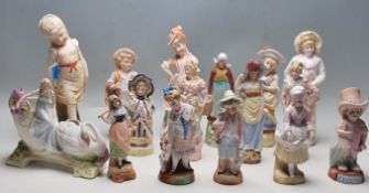 A LARGE COLLECTION OF 20TH CENTURY ANTIQUE BISQUE FIGURINES