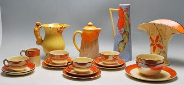 A QUANTITY OF VINTAGE 20TH CENTURY CERAMIC WARE FINISHED IN ORANGE COLOUR