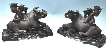 A PAIR OF EARLU 20TH CENTURY CHINESE BULL WITH A B