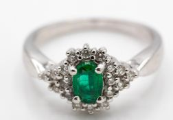 A Hallmarked 18ct White Gold Emerald & Diamond Ring