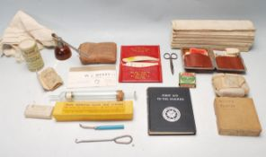 COLLECTION OF VINTAGE MILITARY AND CIVILIAN EARLY 20TH CENTURY FIRST AID ITEMS