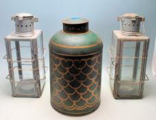 TWO VINTAGE RETRO 20TH CENTURY METAL AND GLASS CANDLE LANTERNS TOGETHER WITH A TEA CANISTER