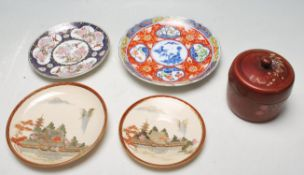 JAPANESE CERAMIC PLATES AND SAUCERS
