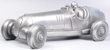 COMPULSION GALLERY PEWTER MODEL OF A 1930'S RACE CAR