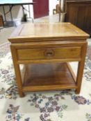 A 20th century Hong Kong hardwood low square-top occasional table fitted with a drawer and