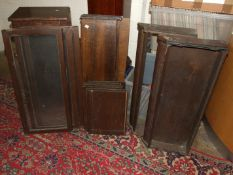 A four-tier oak Globe Wernicke-style bookcase with up-and-over doors, (deconstructed).