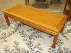 A 20th century Hong Kong hardwood coffee table, 128 x 50cm, 40cm high.
