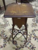 An Art Nouveau-style hardwood plant stand, the top inlaid with birds, on shaped legs and stretchers,