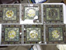 A collection of late-Victorian pictorial leaded-light window and door panels, 7 x 40 x 37cm, (two