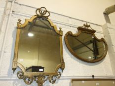 A shaped gilt gesso wall mirror, 100 x 59cm and another, 70 x 78cm, (2).