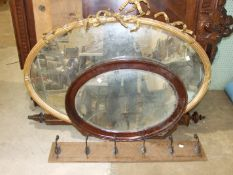 A large oval gilt frame mirror, 118 x 80cm, (some damage), two wood frame mirrors and other items.