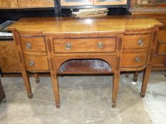 A George III mahogany and rosewood-banded breakfront sideboard, on square tapered legs, 153cm