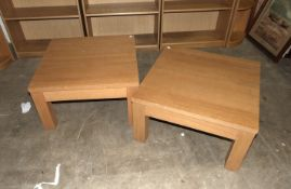A pair of modern oak block-built low coffee tables, 70cm square, (2).
