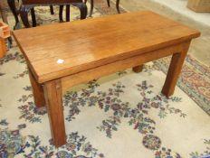 A modern craftsman-built hardwood rectangular coffee table on short chamfered legs, 42cm wide,