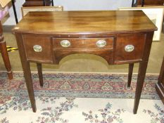 A Georgian-style mahogany small bow-fronted knee-hole dressing table, on tapered legs, 99cm wide,