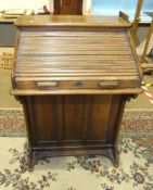 A small oak roll-top 'The Lebus' desk with fitted interior and side drawers, 72cm wide, 106cm high.