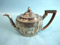 A George III shaped rectangular teapot with oval lid, pineapple finial and wood handle, decorated