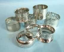 A collection of eight late-19th and 20th century napkin rings of various designs, ___6oz.
