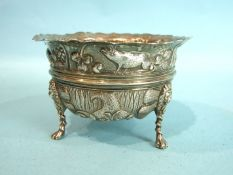 A late-Victorian sugar bowl embossed-overall with swans and pigs, on lion mask and paw feet, 11.