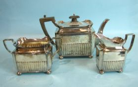 A late-Victorian half-reeded three-piece tea service of oblong shape, on ball feet, Sheffield