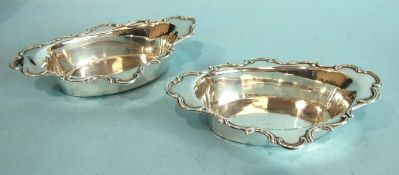 A pair of oval sweetmeat dishes with shaped scroll-edged rims, 17 x 10.5cm, Birmingham 1904,