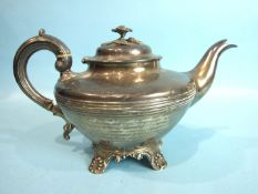 A Victorian silver compressed teapot, the hinged lid with flower finial, raised on shell and foliate