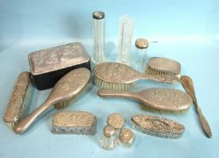 A collection of late-Victorian and early-20th century dressing table brushes, silver-mounted glass