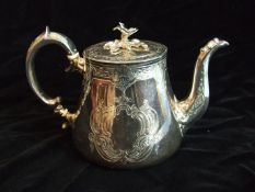 A Victorian teapot of tapered form and good gauge, with flower finial lid, the body engraved with