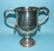 A George V silver presentation two-handled trophy cup on circular base, engraved Abingdon School,