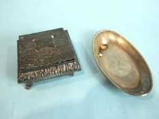 A square embossed jewellery box of compressed form, with overall textured finish, Birmingham 1907