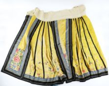 An Imperial-Yellow ground lady's skirt with vertical black lines , decorated with butterflies and