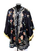 A Chinese dark blue ground tunic, decorated with natural history designs; overall length from collar