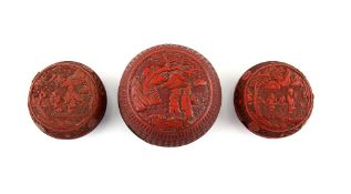 Three Chinese red lacquer boxes; each one of circular form with domed cover; the largest 12 cm