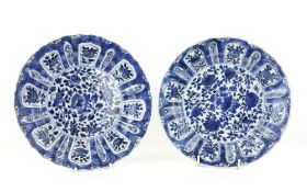 A pair of blue and white dishes; each one decorated with floral and foliage designs; 22.5 cm, Kangxi