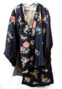 A Chinese textile coat, decorated on the night-blue ground with designs of natural history;