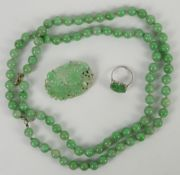 A mottled jadeite or jadeite style necklace mounted with about 85 spherical beads; together with a