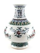 A large doucai style vase with trumpet neck, decorated with floral designs beneath a band of