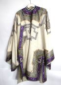 An elegant Chinese [or other Asian] off-white ground robe with wide sleeves, purple-ground facings
