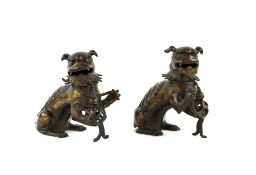 A pair of Chinese gilded-metal alloy incense burners; each one modelled as a Buddhistic Lion with