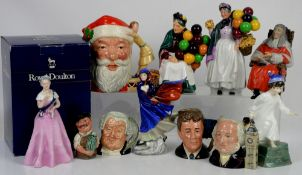 Collection of eleven Royal Doulton figures and jugs,