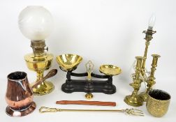Cast iron and brass balance scales with some weights, converted brass oil lamp with globe, brass
