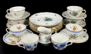 Two Meissen onion pattern cups, Nymphenburg floral decorated teacups, saucers and plates, and