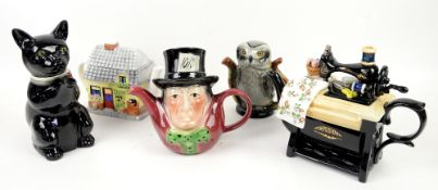 A collection of 32 teapots to include Carlton Ware, Royal Doulton and Tony Wood